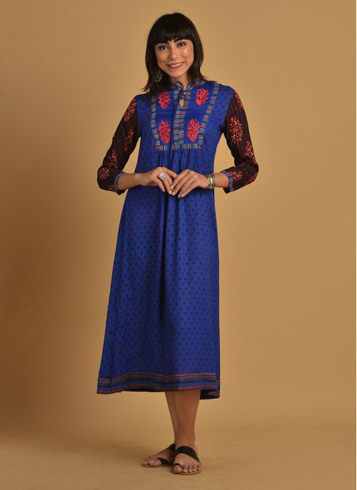 Blue Rayon Printed Flare With Embroidered Yoke And Tassles Kurti