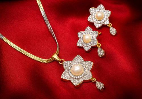 Craftsvilla Gold Plated Alloy Metal Designer American Diamond Pendant Set With Chain