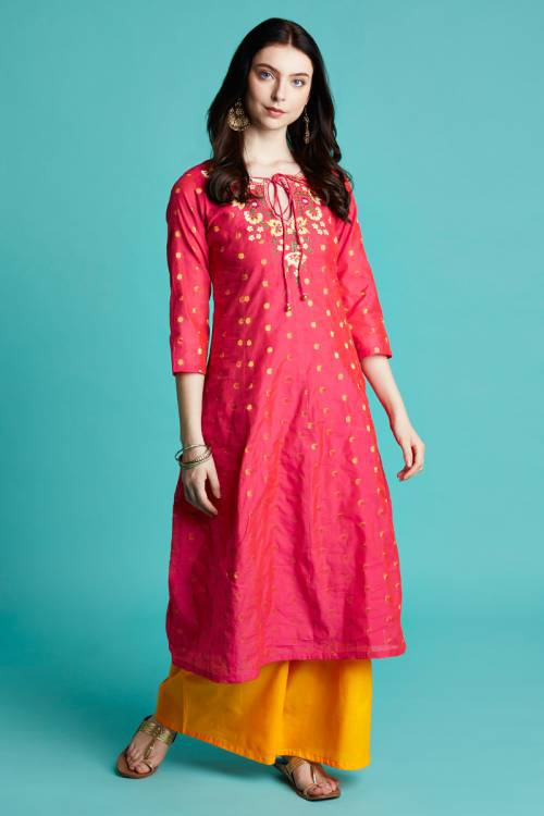 A-line Pink Color Kurta Set In Dot Jacquard Fabric With  Embroidered Neckline And Contrast Palazzo.